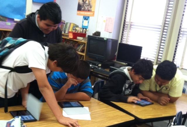 students using imovie ipad