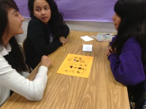 Students playing board game to learn at school